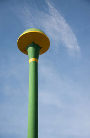 hold up: green public water tank hold up to blue sky