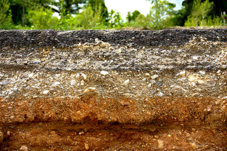 corrode: Layer of asphalt road was scour, Corrode, well-worn and clipped Stock Photo