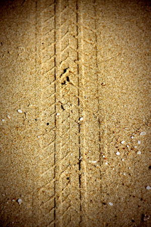texture of tire tracks on dry sand