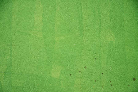 green brush marks painted cement walls photo