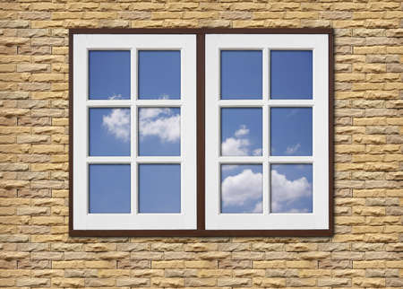 white wood window on stone walls and blue sky reflection window glass