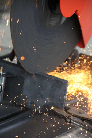 cutting steel with grinder machine close up photo