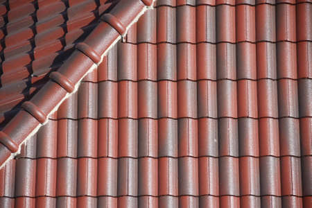 red-brown roof tiles strong was safety sunshine  and rain