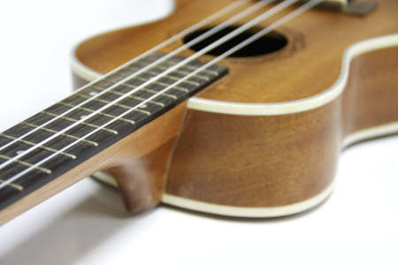 soprano: part and texture of brown wood ukulele on white background