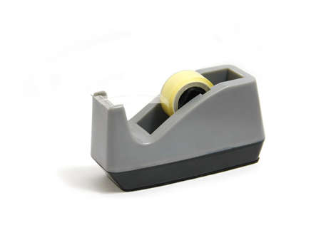 gray of shoe tape dispenser and tape on white background Imagens