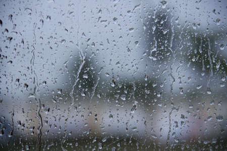 rain window: water drop, rain drop on glass and dripping down