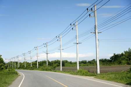 telegraphs: row of wire pole inside road on countryside withe blue sky