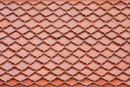 red roof tile have pattern like fish scales photo