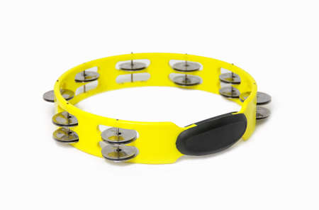 yellow plastic tambourine on white background Banco de Imagens