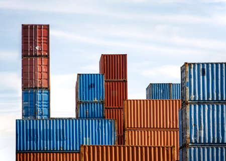 Stack of Cargo Containers in an intermodal yard with blue sky photo