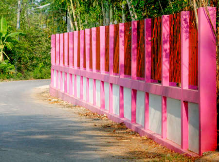 cement pole: beautiful pink painting on cement fence