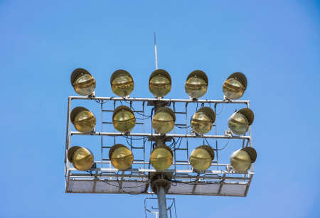 halogen lighting: metal stadium lights for sport field with blue sky in background