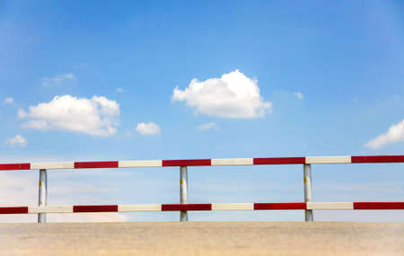 dangerous traffic fence beside street with blue sky for safety photo