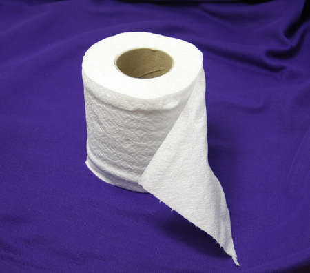 Roll Fresh Tissue On Purple Cloth For Convenience Stock Photo
