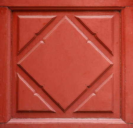 beautiful red paint on wood floral pattern of door and window interior photo
