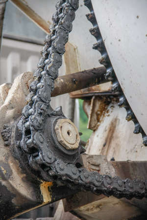 grease: old chain with grease on propel roller for motor powered