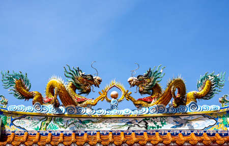 china dragon on roof of Door Shrine photo
