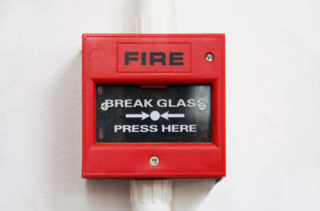 sprinkler alarm: fire alarm box on cement wall for warning and security system