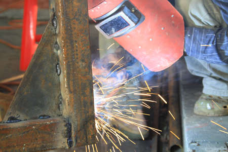 welding steel iron with smoke photo