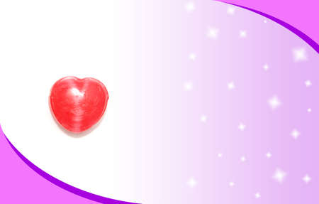 heart candy on beautiful pink card photo