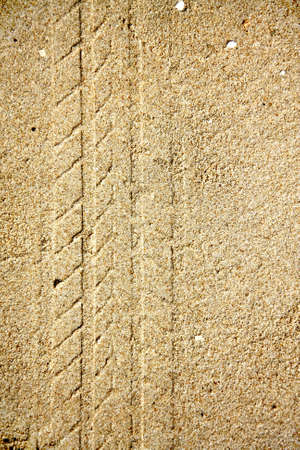 texture of tire tracks on dry sand photo
