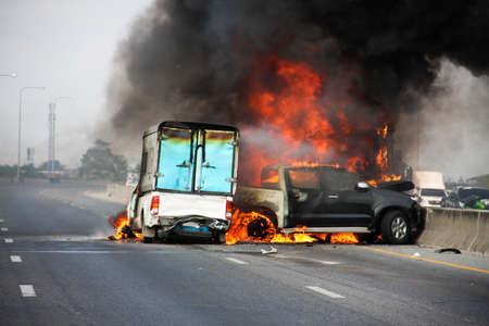 car crime: small truck with Truck caps car explosive car crash and catch fire on motorway