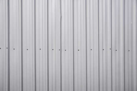 pattern silver metal sheet roof, wall with nut for industry background photo