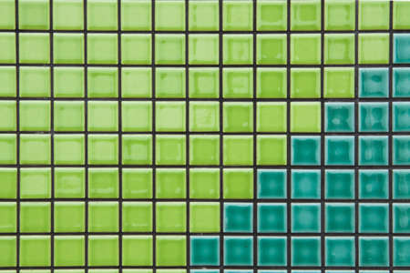 green color mosaic tiles texture with gray filling photo