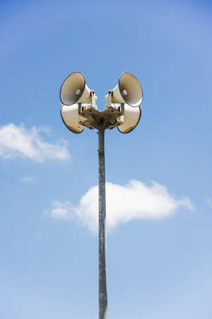 public address: megaphone pole with blue sky and clouds Stock Photo