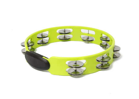 green plastic tambourine on white background
