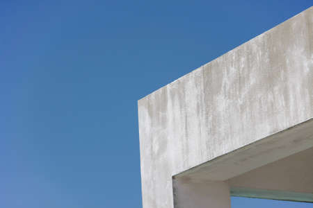 cornerstone: edge of concrete roof of building with blue sky