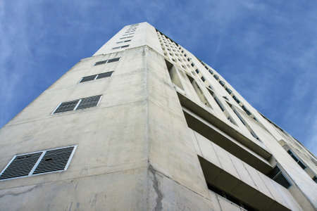 angular conceate tower with blue sky