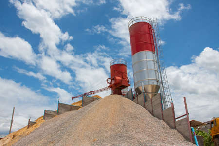 concrete batching plant, heap of sand and gravel, cement material stationary Standard-Bild