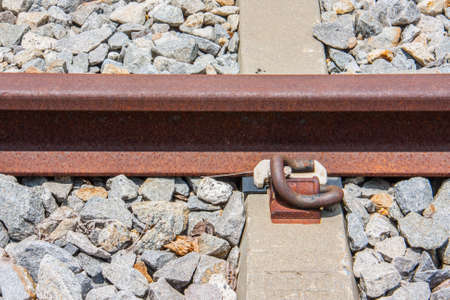sleeper: close-up of rail fastener with concrete sleeper