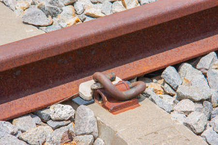 fastener: close-up of rail fastener with concrete sleeper
