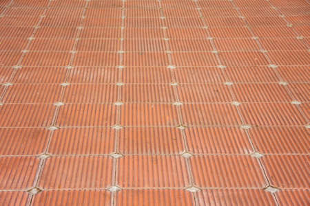 brick clay: beautiful patio of square red brick clay tile floor with rough pattern style Stock Photo