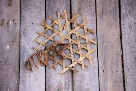 beliefs: weave bamboo on wooden wall of Hmong holidays sign and lucky beliefs