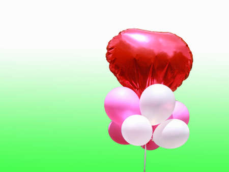 colorful balloons with heart on greenbackground
