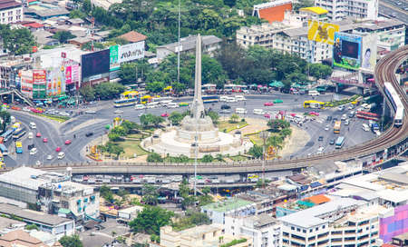 Bangkok, Thailand - April 12, 2014: Victory Monument, Bangkoks major traffic intersections, military monument erected in June 1941 to commemorate the Thai victory in the Franco-Thai War. Editorial