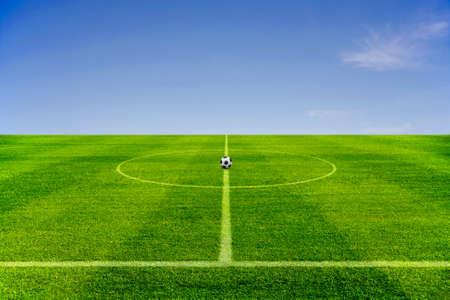 soccer ball on center green Football field, start concept Stock Photo