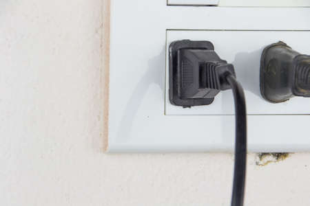 plug in socket and switch on soft pink wall of room