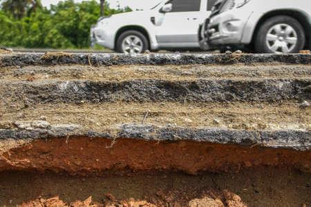 broken layer of asphalt road