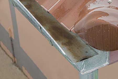 rainwater falling on gutter drainage Stock Photo