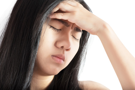 remedial: Headache symptom in a woman isolated on white background.