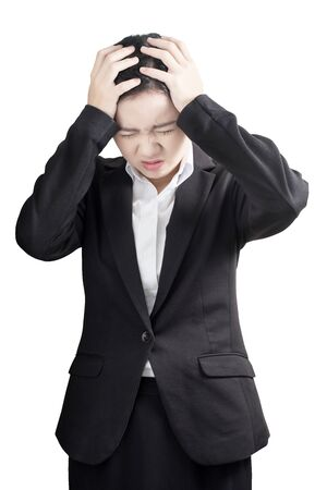 remedial: Headache symptom in a businesswoman isolated on white background. Clipping path on white background