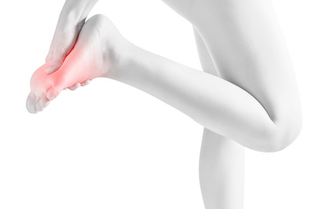 Acute pain in a woman feet isolated on white background. Clipping path on white background Stock Photo