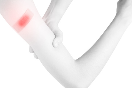 Acute pain in a woman arm isolated on white background. Clipping path on white background