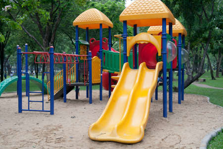 Playground slide in a public garden,  Stock Photo