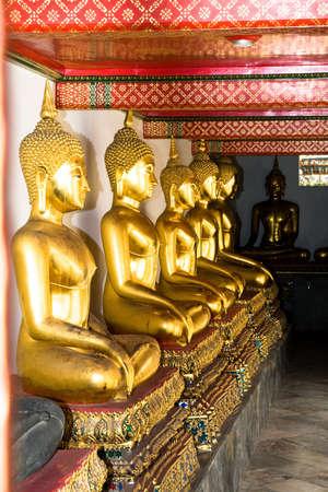 aligned: Aligned gold buddha