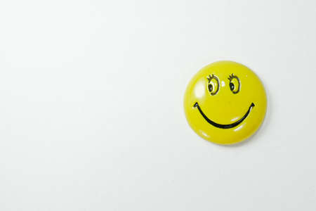 A smiling magnet on white background